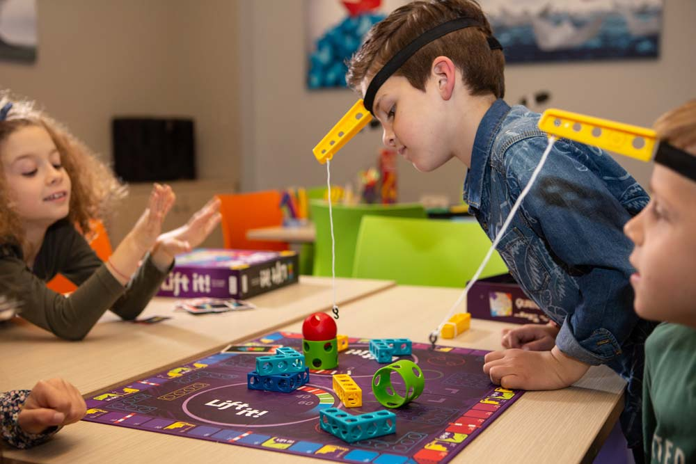 "kids enjoy playing board game ""Lift It"""